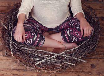 lady sitting on nest
